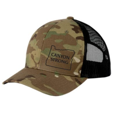 "camo ballcap with black mesh on the back and with black outline of Oregon and the words ""canyon strong"""